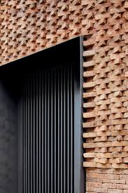 Brick facade detail - apartment in Santiago, Chile by Mapa