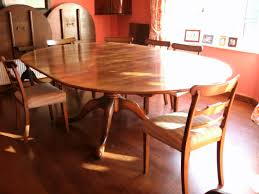 round pedestal extending table in our tudor finish