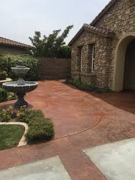 which is better for coloring a concrete patio paint or stain
