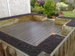 deck and patio with hardwood floor tiles and soil mix for raised bed vegetable garden plan in the backyard garden house design ideas