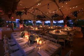 levy lighting used string lights to illuminate an outdoor tent at a private labor day party