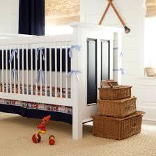 wicker baskets on carpet plus madras plaid beach themed bedding