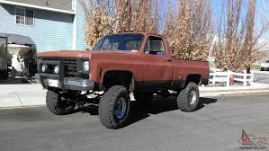 Chevrolet Gmc lifted brown blue truck