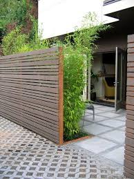 great garden gate I want my backyard to look like this! Patio Modern Garden  Design Planted privacy screen + mix of paving pattern.