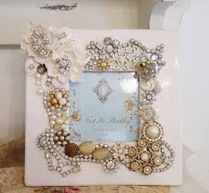 Recycled jewelry decorated frame the white frame makes this very