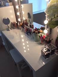 dressing table lighting.  dressing on my dressing table i have brushes in ikea plant pots with dressing table lighting