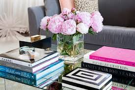 The best way to tie your room together is with a stylish coffee table. Styled Mirrored Cocktail Table With Designer Coffee Table Books Contemporary Living Room