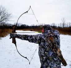denny sturgis jr showing a er on his hunting recurve bow
