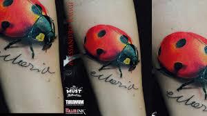 Coccinella Realistica Tatuaggio A Colori Sul Braccio Alessandro Raggi