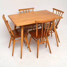 a beautiful and compact dining set by ercol this dates from around the 1960s