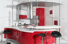 a modern take on a retro kitchen with curved red cabinets chrome accents retro