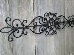 iron wall scroll marvellous inspiration ideas metal wall scrolls home pictures scroll enchanting decor endearing design
