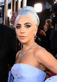 lady a dyes hair blue to match dress for the 2019 golden globes allure
