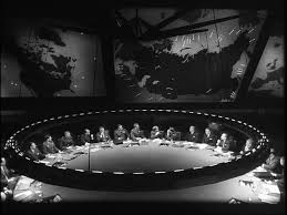 "take dr strangelove or how i learned to stop worrying and  the centerpiece of the room is the wide round table and the backdrop is the all important ""big board"" each providing the two biggest sources of light in"