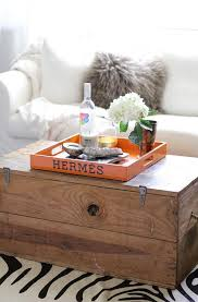 trunk coffee table with orange hermes tray