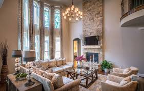 transitional family room double sink beside timber glass wall crystal chandelier in high ceiling elegant browl