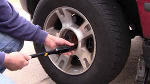 How To Change Tire On 2004 Ford Explorer Spare Tire Youtube