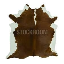 stockroom brown and white split natural cowhide rug
