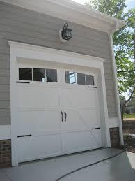 add trim to garage door add hardware to you boring garage door to give it a quick update