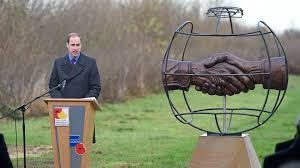 Prince William dedicates a monument to the Christmas truce in 2014. goal.com