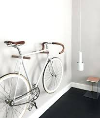 bike wall hanger an amazing way of up your bike wall hooks in wood for displaying your bike wall storage diy