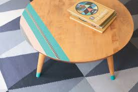 Pimp up a coffee table with pastel coloured washi tape or just a little  paint.