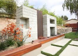 View in gallery Orange flowering plants in a modern yard
