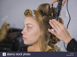Pretty Woman Hair Style professional hairdresser doing hairstyle for young pretty woman 1014 by wearticles.com