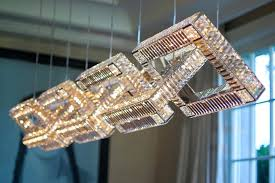 small hanging crystal chandelier lights shaped cream modern hanging living room chandeliers besides white small sofa