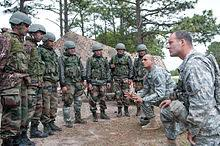 united states relations  sgt balkrishna dave an born u s army paratrooper explains weapons range safety procedures to n army iers before they fire american machine