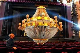 liverpool empire ion manager spencer new inspects the chandelier