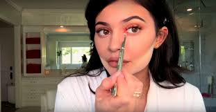 kylie jenner applies lip liner with her