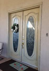 the homeowner chose to have our team replace the entire entry door system the result right is this stunning french door with flat bronze hardware
