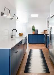 this home received an updated kitchen blue cabinets and white kitchens pictures this in austin