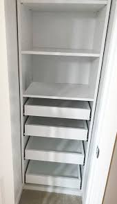 bathroom linen closet with pull out shelves
