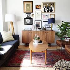 living room midcentury modern living room with oval table on persian rug also retro wall