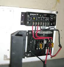diy truck or rv mounted pv system fuse block above and morningstar charge controller below