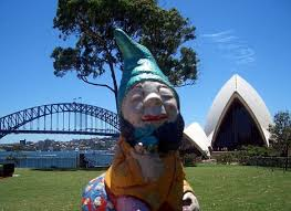 on holiday murphy the leprechaun poses for a picture in front of sydney opera house