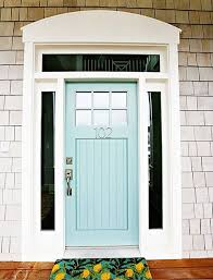 a wooden powder blue front door with gl panels on either side the door has