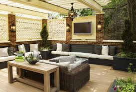 Outdoor Modern Family Room With Tv In A Moroccan Style With Rattan