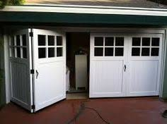 Clear Glass Garage Doors With Passing Door On Greenhouse And