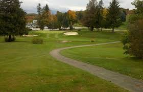 a view of a green protected by sand traps at greene county country club greene county cc