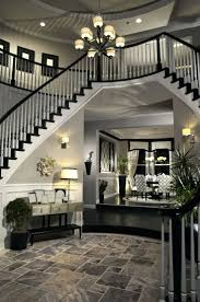 2 story foyer chandelier. 2 Story Foyer Lighting Ideas Chandelier Installation Double Arched Stairs Descending Down The Round Entrancefoyer Creating A Two