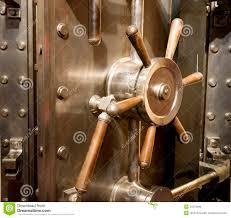 front of bank vault mive door handle bination lock dial