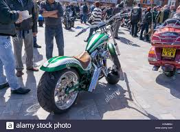 custom built harley davidson motorcycle displayed at a street show