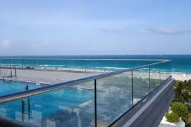 the islander iniums recently renovated their rooftop terrace with our fully frameless glass railing system the client wanted to replace the existing