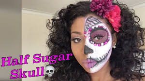 half sugar skull day of the dead makeup