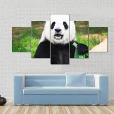 giant panda is eating green bamboo leaf canvas panel painting tiaracle on giant panda wall art with giant panda eating green bamboo leaf multi panel canvas wall art