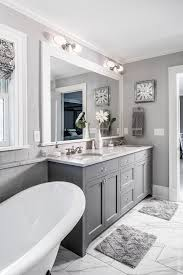 gray bathroom with white cabinets. love the grey cabinets and extra counter space wide baseboards, way sink is inset. cabinet paint color benjamin moore kendall gray bathroom with white o