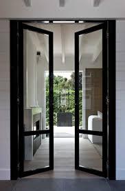 narrow glass hallway door leading outside the house